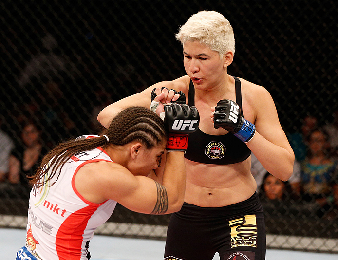 BRASILIA, BRAZIL - SEPTEMBER 13:  (R-L) Larissa Pacheco of Brazil punches Jessica Andrade of Brazil in their women's bantamweight bout during the UFC Fight Night event inside Nilson Nelson Gymnasium on September 13, 2014 in Brasilia, Brazil.  (Photo by Josh Hedges/Zuffa LLC/Zuffa LLC via Getty Images)