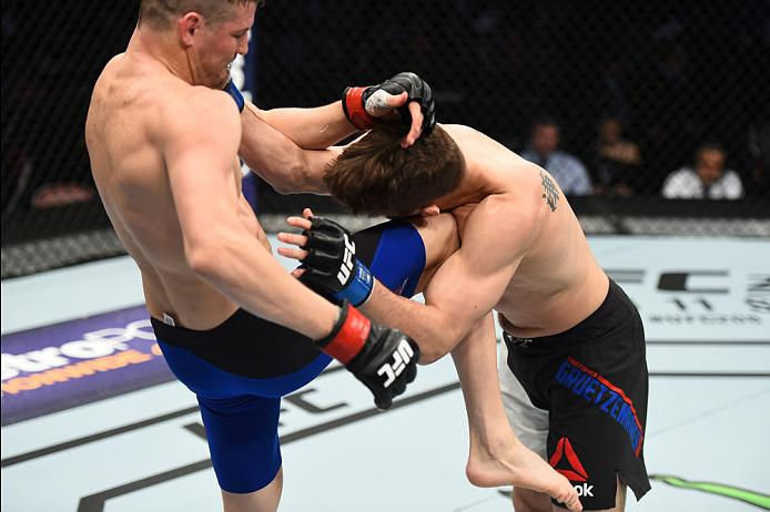 HOUSTON, TX - FEBRUARY 04:  (L-R) Chas Skelly knees Chris Gruetzemacher in their featherweight bout during the UFC Fight Night event at the Toyota Center on February 4, 2017 in Houston, Texas. (Photo by Jeff Bottari/Zuffa LLC/Zuffa LLC via Getty Images)