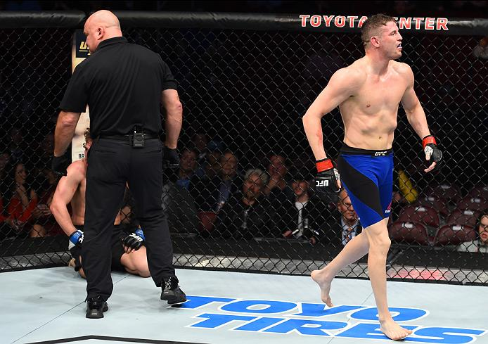 HOUSTON, TX - FEBRUARY 04:  (L-R) Chas Skelly celebrates his submission victory over Chris Gruetzemacher in their featherweight bout during the UFC Fight Night event at the Toyota Center on February 4, 2017 in Houston, Texas. (Photo by Jeff Bottari/Zuffa LLC/Zuffa LLC via Getty Images)