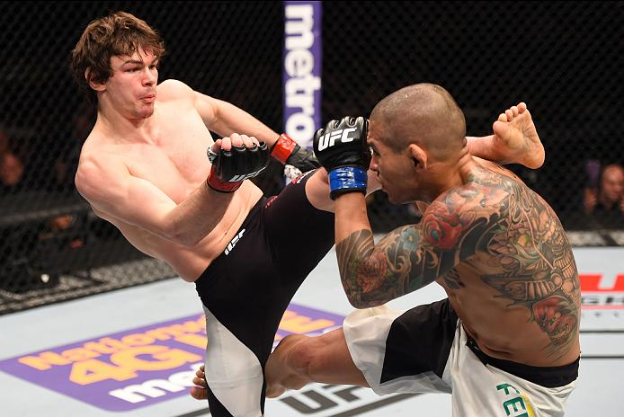 NEWARK, NJ - JANUARY 30:  (L-R) Olivier Aubin-Mercier kicks Diego Ferreira in their lightweight bout during the UFC Fight Night event at the Prudential Center on January 30, 2016 in Newark, New Jersey. (Photo by Josh Hedges/Zuffa LLC/Zuffa LLC via Getty Images)