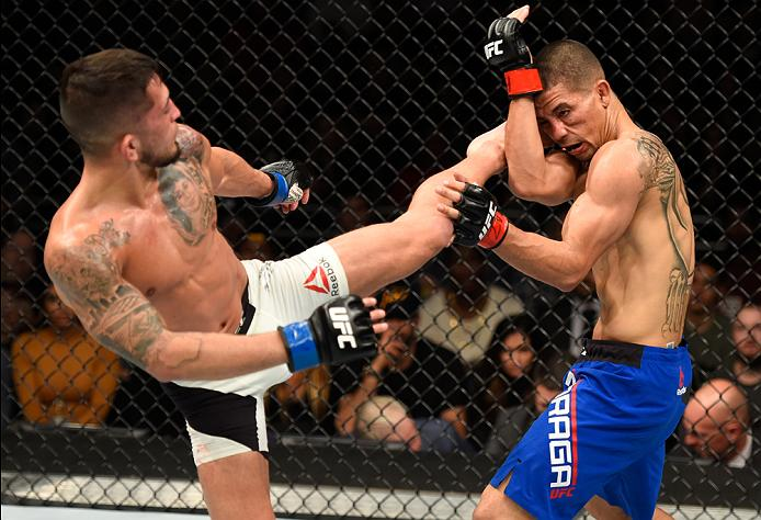 PHOENIX, AZ - JANUARY 15: (L-R) Sergio Pettis kicks <a href='../fighter/John-Moraga'>John Moraga</a> in their flyweight bout during the UFC Fight Night event inside Talking Stick Resort Arena on January 15, 2017 in Phoenix, Arizona. (Photo by Jeff Bottari/Zuffa LLC)