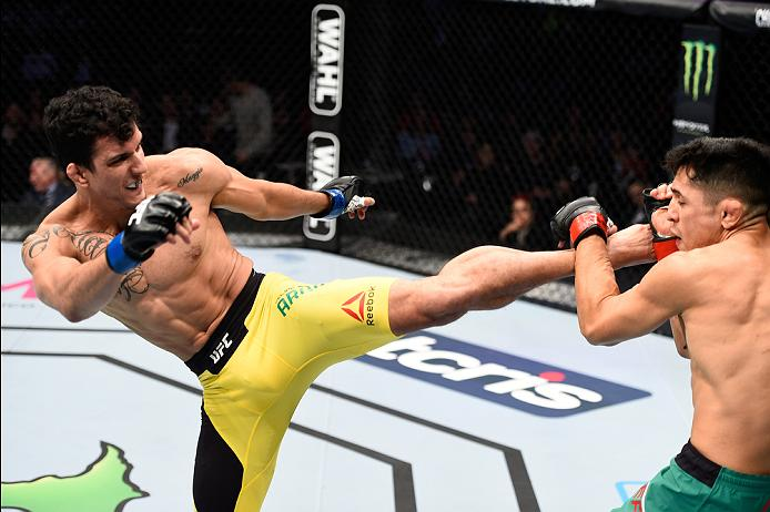 MEXICO CITY, MEXICO - NOVEMBER 05:  (L-R) Felipe Arantes of Brazil kicks Erik Perez of Mexico in their bantamweight bout during the UFC Fight Night event at Arena Ciudad de Mexico on November 5, 2016 in Mexico City, Mexico. (Photo by Jeff Bottari/Zuffa LLC/Zuffa LLC via Getty Images)
