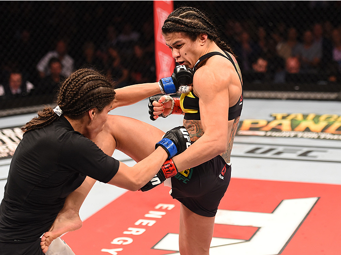 RIO DE JANEIRO, BRAZIL - AUGUST 01:  (R-L) Claudia Gadelha of Brazil kicks Jessica Aguilar of the United States in their women's strawweight bout during the UFC 190 event inside HSBC Arena on August 1, 2015 in Rio de Janeiro, Brazil.  (Photo by Josh Hedges/Zuffa LLC/Zuffa LLC via Getty Images)