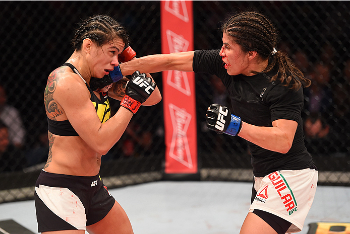 RIO DE JANEIRO, BRAZIL - AUGUST 01:  (R-L) Jessica Aguilar of the United States punches Claudia Gadelha of Brazil in their women's strawweight bout during the UFC 190 event inside HSBC Arena on August 1, 2015 in Rio de Janeiro, Brazil.  (Photo by Josh Hedges/Zuffa LLC/Zuffa LLC via Getty Images)