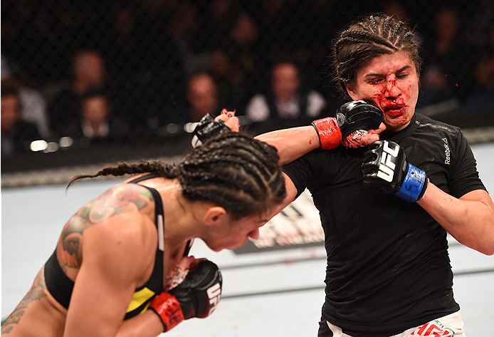 RIO DE JANEIRO, BRAZIL - AUGUST 01:  (L-R) Claudia Gadelha of Brazil punches Jessica Aguilar of the United States in their women's strawweight bout during the UFC 190 event inside HSBC Arena on August 1, 2015 in Rio de Janeiro, Brazil.  (Photo by Josh Hedges/Zuffa LLC/Zuffa LLC via Getty Images)