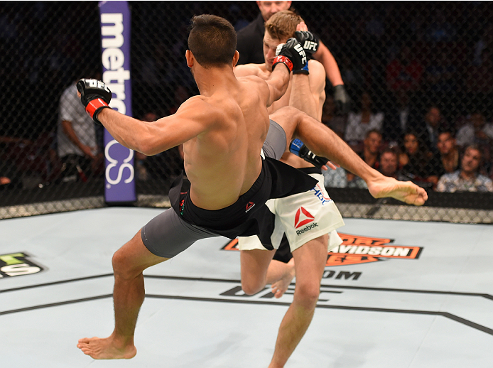 HOUSTON, TX - OCTOBER 03:  (L-R) Yair Rodriguez kicks Dan Hooker in their featherweight bout during the UFC 192 event at the Toyota Center on October 3, 2015 in Houston, Texas. (Photo by Josh Hedges/Zuffa LLC/Zuffa LLC via Getty Images)