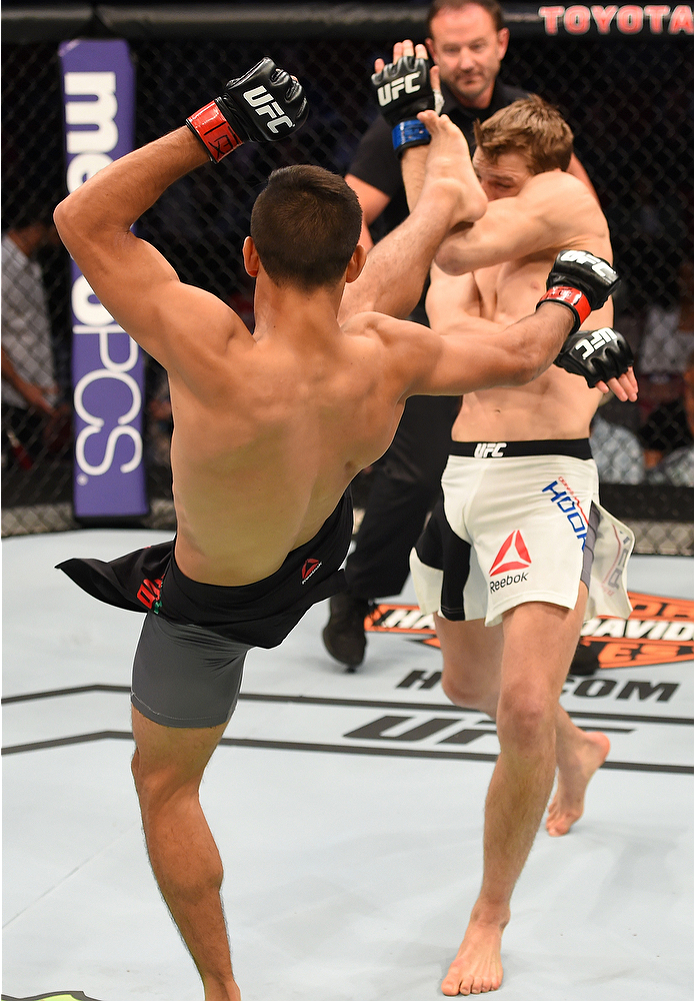 HOUSTON, TX - OCTOBER 03:  Yair Rodriguez kicks Dan Hooker in their featherweight bout during the UFC 192 event at the Toyota Center on October 3, 2015 in Houston, Texas. (Photo by Josh Hedges/Zuffa LLC/Zuffa LLC via Getty Images)
