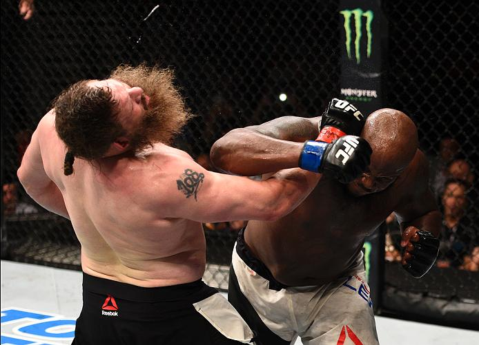 LAS VEGAS, NV - JULY 07: (R-L) Derrick Lewis connects with a right hand against Roy Nelson in their heavyweight bout during the UFC Fight Night event inside the MGM Grand Garden Arena on July 7, 2016 in Las Vegas, Nevada. (Photo by Jeff Bottari/Zuffa LLC/Zuffa LLC via Getty Images)