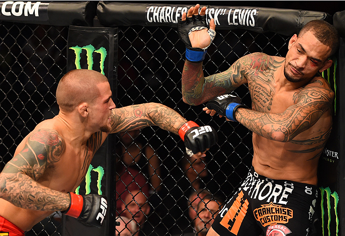 Dustin Poirier punches Yancy Medeiros in their lightweight bout during the UFC event at the Smoothie King Center on June 6, 2015 in New Orleans, Louisiana. (Photo by Josh Hedges/Zuffa LLC)
