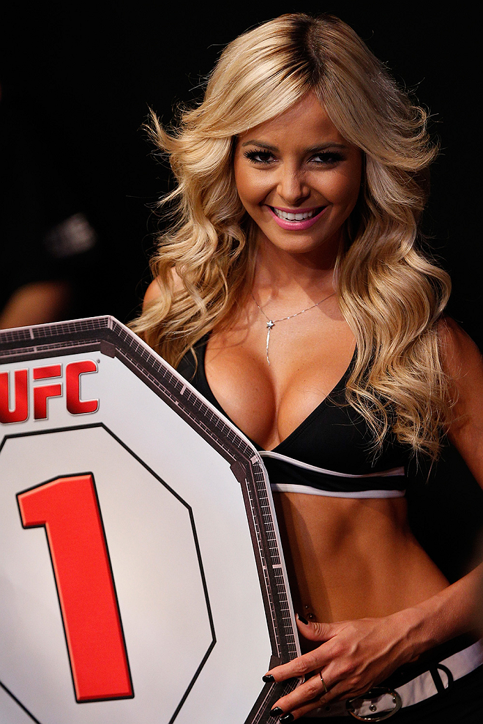 BRASILIA, BRAZIL - SEPTEMBER 13:  UFC Octagon Girl Jhenny Andrade introduces a round during the UFC Fight Night event inside Nilson Nelson Gymnasium on September 13, 2014 in Brasilia, Brazil.  (Photo by Josh Hedges/Zuffa LLC/Zuffa LLC via Getty Images)