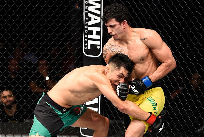 MEXICO CITY, MEXICO - NOVEMBER 05:  (R-L) Felipe Arantes of Brazil punches Erik Perez of Mexico in their bantamweight bout during the UFC Fight Night event at Arena Ciudad de Mexico on November 5, 2016 in Mexico City, Mexico. (Photo by Jeff Bottari/Zuffa LLC/Zuffa LLC via Getty Images)