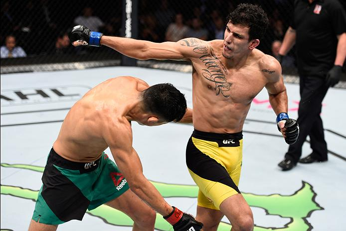 MEXICO CITY, MEXICO - NOVEMBER 05:  (R-L) Felipe Arantes of Brazil throws a spinning back fist at Erik Perez of Mexico in their bantamweight bout during the UFC Fight Night event at Arena Ciudad de Mexico on November 5, 2016 in Mexico City, Mexico. (Photo by Jeff Bottari/Zuffa LLC/Zuffa LLC via Getty Images)