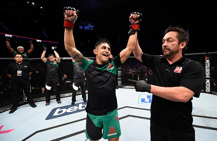 MEXICO CITY, MEXICO - NOVEMBER 05:  Erik Perez of Mexico celebrates his victory over Felipe Arantes of Brazil in their bantamweight bout during the UFC Fight Night event at Arena Ciudad de Mexico on November 5, 2016 in Mexico City, Mexico. (Photo by Jeff Bottari/Zuffa LLC/Zuffa LLC via Getty Images)