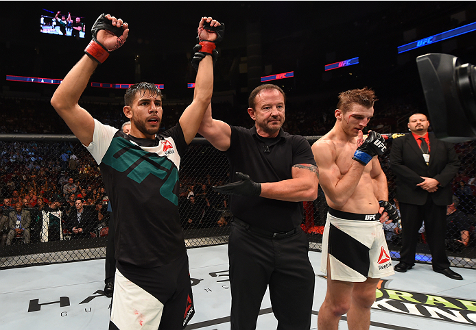HOUSTON, TX - OCTOBER 03:  (L-R) Yair Rodriguez celebrates his victory over Dan Hooker in their featherweight bout during the UFC 192 event at the Toyota Center on October 3, 2015 in Houston, Texas. (Photo by Josh Hedges/Zuffa LLC/Zuffa LLC via Getty Images)
