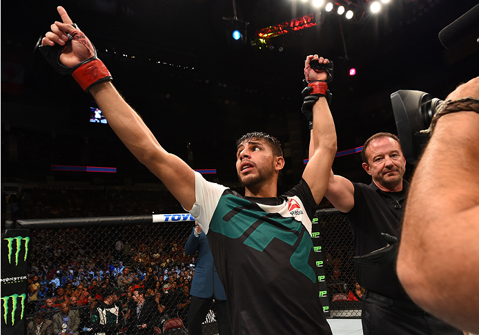 HOUSTON, TX - OCTOBER 03:  Yair Rodriguez celebrates his victory over Dan Hooker in their featherweight bout during the UFC 192 event at the Toyota Center on October 3, 2015 in Houston, Texas. (Photo by Josh Hedges/Zuffa LLC/Zuffa LLC via Getty Images)