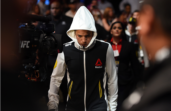 HOUSTON, TX - OCTOBER 03:  Julianna Pena prepares to enter the Octagon before facing Jessica Eye in their women's bantamweight bout during the UFC 192 event at the Toyota Center on October 3, 2015 in Houston, Texas. (Photo by Josh Hedges/Zuffa LLC/Zuffa LLC via Getty Images)