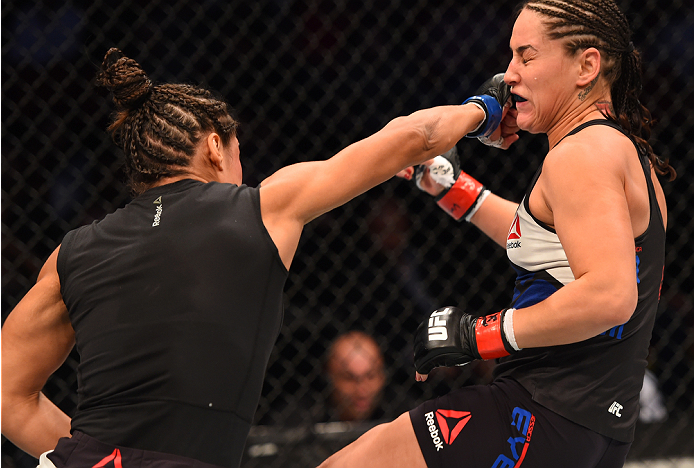 HOUSTON, TX - OCTOBER 03:  (L-R) Julianna Pena punches Jessica Eye in their women's bantamweight bout during the UFC 192 event at the Toyota Center on October 3, 2015 in Houston, Texas. (Photo by Josh Hedges/Zuffa LLC/Zuffa LLC via Getty Images)
