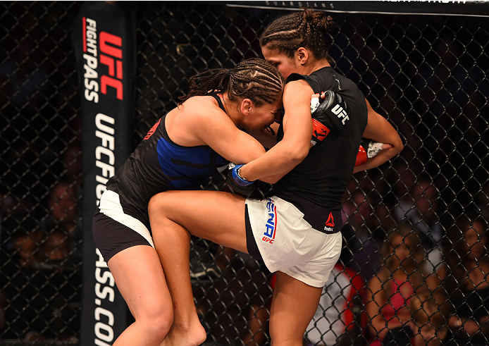HOUSTON, TX - OCTOBER 03:  (R-L) Julianna Pena knees Jessica Eye in their women's bantamweight bout during the UFC 192 event at the Toyota Center on October 3, 2015 in Houston, Texas. (Photo by Josh Hedges/Zuffa LLC/Zuffa LLC via Getty Images)