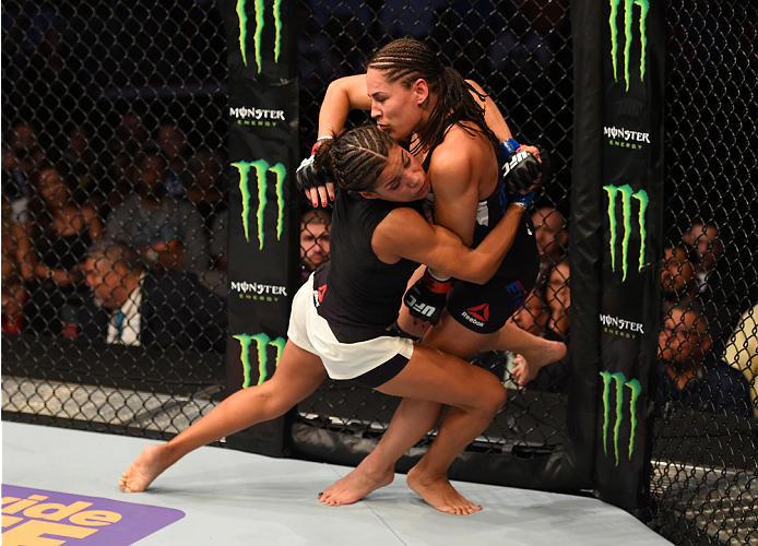 HOUSTON, TX - OCTOBER 03:  (L-R) Julianna Pena takes down Jessica Eye in their women's bantamweight bout during the UFC 192 event at the Toyota Center on October 3, 2015 in Houston, Texas. (Photo by Josh Hedges/Zuffa LLC/Zuffa LLC via Getty Images)