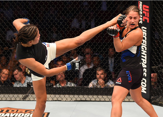 HOUSTON, TX - OCTOBER 03:  (L-R) Julianna Pena kicks Jessica Eye in their women's bantamweight bout during the UFC 192 event at the Toyota Center on October 3, 2015 in Houston, Texas. (Photo by Josh Hedges/Zuffa LLC/Zuffa LLC via Getty Images)