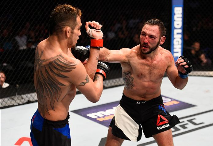 <a href='../fighter/Landon-Vannata'>Lando Vannata</a> punches <a href='../fighter/Tony-Ferguson'>Tony Ferguson</a> during his UFC debut in July