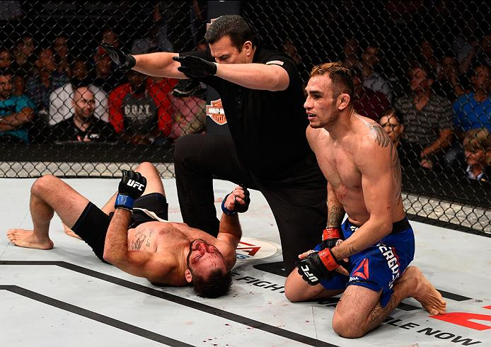 SIOUX FALLS, SD - JULY 13:   (R-L) Tony Ferguson celebrates his submission victory over Lando Vannat in their lightweight bout during the UFC Fight Night event on July 13, 2016 at Denny Sanford Premier Center in Sioux Falls, South Dakota. (Photo by Jeff Bottari/Zuffa LLC/Zuffa LLC via Getty Images)