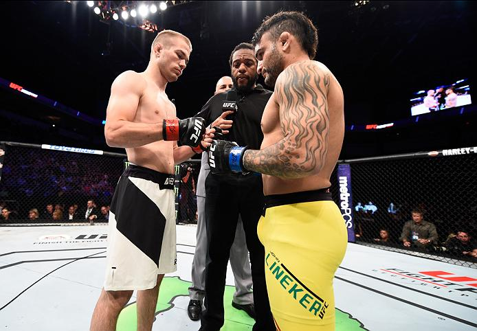 SIOUX FALLS, SD - JULY 13: (R-L) John Lineker and Michael McDonald touch gloves in their bantamweight bout during the UFC Fight Night event on July 13, 2016 at Denny Sanford Premier Center in Sioux Falls, South Dakota. (Photo by Jeff Bottari/Zuffa LLC/Zuffa LLC via Getty Images)