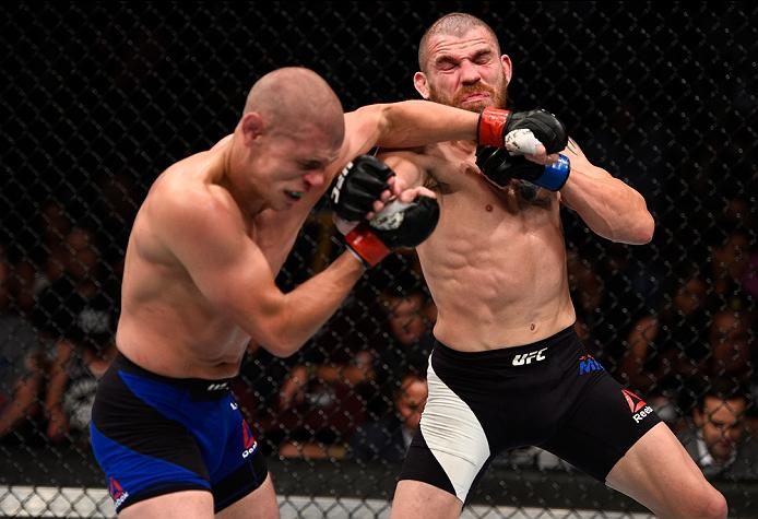 VANCOUVER, BC - AUGUST 27:  (R-L) Jim Miller of the United States exchanges punches with Joe Lauzon of the United States in their lightweight bout during the UFC Fight Night event at Rogers Arena on August 27, 2016 in Vancouver, British Columbia, Canada. (Photo by Jeff Bottari/Zuffa LLC/Zuffa LLC via Getty Images)