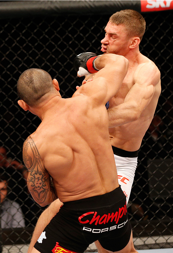 BRASILIA, BRAZIL - SEPTEMBER 13: (L-R) Gleison Tibau of Brazil punches Piotr Hallmann of Poland in their lightweight bout during the UFC Fight Night event inside Nilson Nelson Gymnasium on September 13, 2014 in Brasilia, Brazil. (Photo by Josh Hedges/Zuffa LLC/Zuffa LLC via Getty Images)