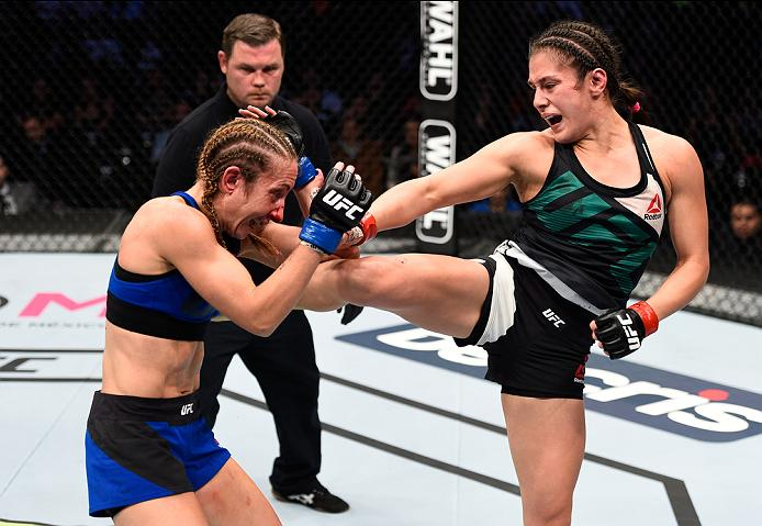 MEXICO CITY, MEXICO - NOVEMBER 05:  (R-L) Alexa Grasso of Mexico kicks Heather Jo Clark of the United States in their women's strawweight bout during the UFC Fight Night event at Arena Ciudad de Mexico on November 5, 2016 in Mexico City, Mexico. (Photo by Jeff Bottari/Zuffa LLC/Zuffa LLC via Getty Images)