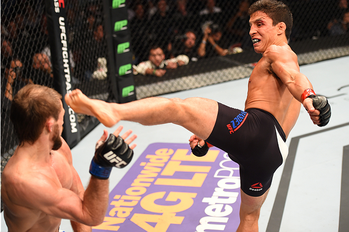 HOUSTON, TX - OCTOBER 03:  (R-L) Joseph Benavidez kicks Ali Bagautinov in their flyweight bout during the UFC 192 event at the Toyota Center on October 3, 2015 in Houston, Texas. (Photo by Josh Hedges/Zuffa LLC/Zuffa LLC via Getty Images)