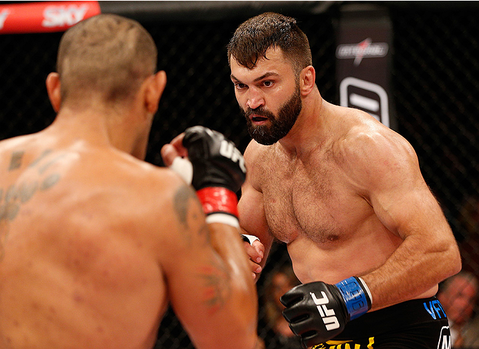 "BRASILIA, DF - SEPTEMBER 13: (R-L) Andrei Arlovski of Belarus squares off with Antonio ""Bigfoot"" Silva of Brazil in their heavyweight bout during the UFC Fight Night event inside Nilson Nelson Gymnasium on September 13, 2014 in Brasilia, Brazil. (Photo by Josh Hedges/Zuffa LLC/Zuffa LLC via Getty Images)"