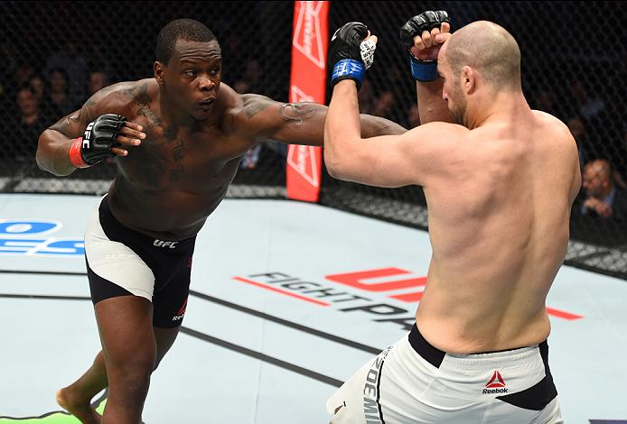HOUSTON, TX - FEBRUARY 04:  (L-R) Ovince Saint Preux punches Volkan Oezdemir of Switzerland in their light heavyweight bout during the UFC Fight Night event at the Toyota Center on February 4, 2017 in Houston, Texas. (Photo by Jeff Bottari/Zuffa LLC/Zuffa LLC via Getty Images)