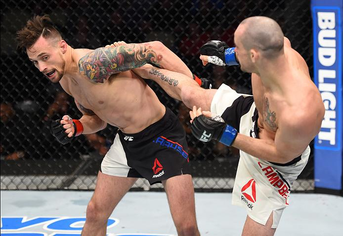PITTSBURGH, PA - FEBRUARY 21:  (R-L) Chris Camozzi kicks Joe Riggs in their middleweight bout during the UFC Fight Night event at Consol Energy Center on February 21, 2016 in Pittsburgh, Pennsylvania. (Photo by Jeff Bottari/Zuffa LLC/Zuffa LLC via Getty Images)