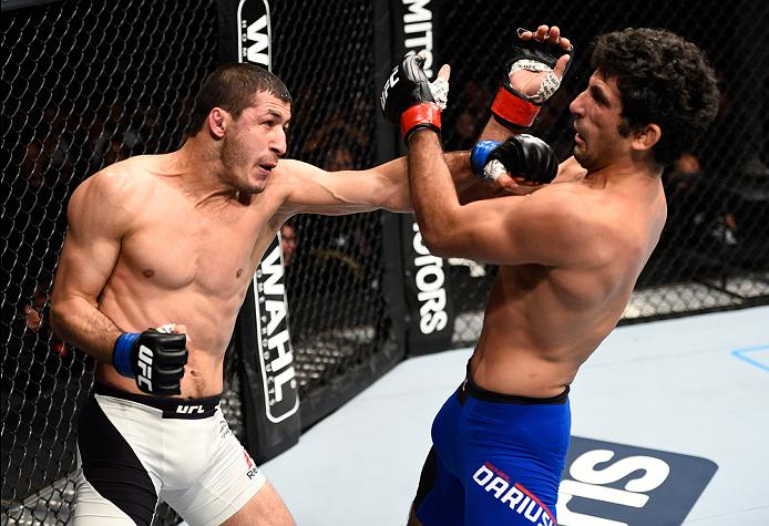 MEXICO CITY, MEXICO - NOVEMBER 05:  (L-R) Rashid Magomedov of Russia punches Beneil Dariush of Iran in their lightweight bout during the UFC Fight Night event at Arena Ciudad de Mexico on November 5, 2016 in Mexico City, Mexico. (Photo by Jeff Bottari/Zuffa LLC/Zuffa LLC via Getty Images)