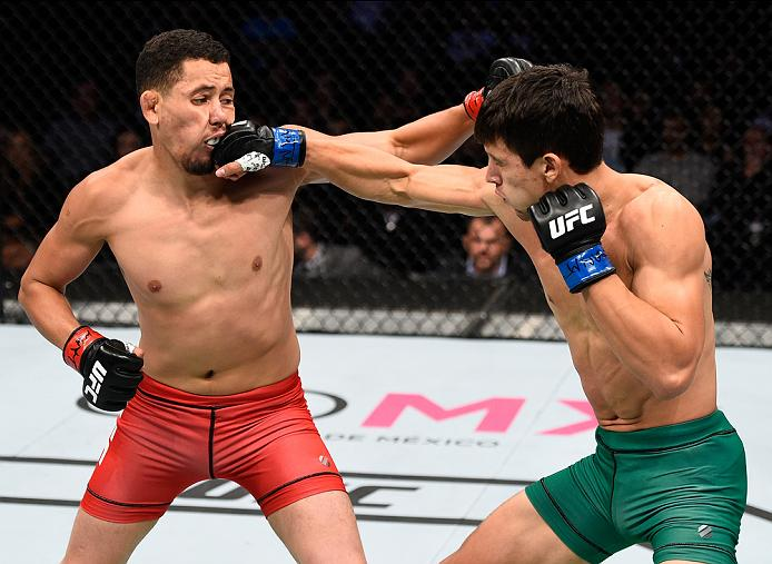 MEXICO CITY, MEXICO - NOVEMBER 05:  (R-L) Claudio Puelles of Peru punches Martin Bravo Flores of Mexico in their lightweight bout during the UFC Fight Night event at Arena Ciudad de Mexico on November 5, 2016 in Mexico City, Mexico. (Photo by Jeff Bottari/Zuffa LLC/Zuffa LLC via Getty Images)