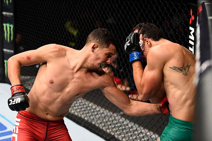 MEXICO CITY, MEXICO - NOVEMBER 05:  (L-R) Martin Bravo Flores of Mexico punches Claudio Puelles of Peru in their lightweight bout during the UFC Fight Night event at Arena Ciudad de Mexico on November 5, 2016 in Mexico City, Mexico. (Photo by Jeff Bottari/Zuffa LLC/Zuffa LLC via Getty Images)