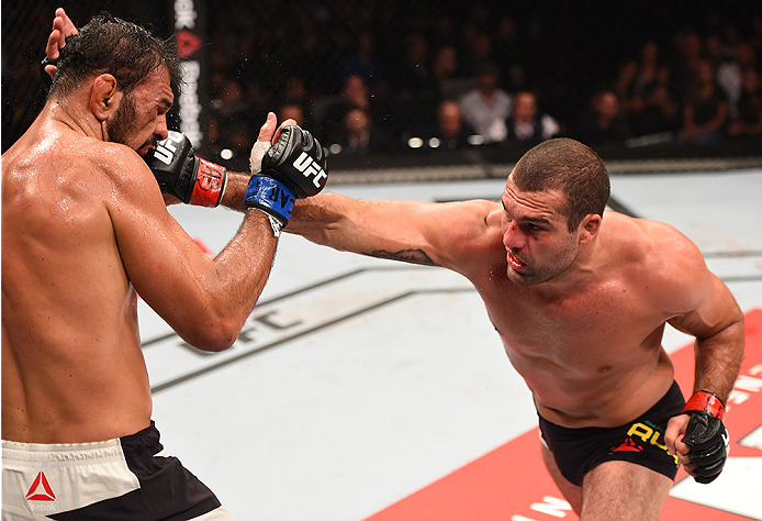 (L-R) Mauricio 'Shogun' Rua of Brazil punches Rogerio Nogueira of Brazil in their light heavyweight bout during UFC 190 on August 1, 2015 in Rio de Janeiro, Brazil. (Photo by Josh Hedges/Zuffa LLC)