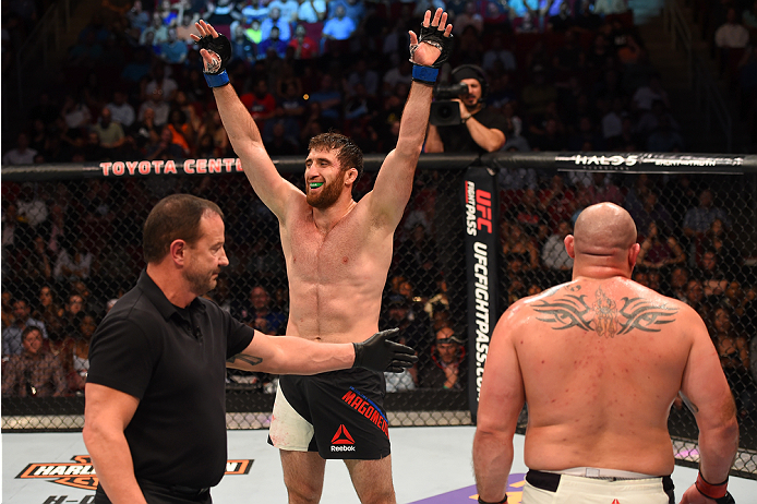 HOUSTON, TX - OCTOBER 03:  (L-R) Ruslan Magomedov raises his hands after facing Shawn Jordan in their heavyweight bout during the UFC 192 event at the Toyota Center on October 3, 2015 in Houston, Texas. (Photo by Josh Hedges/Zuffa LLC/Zuffa LLC via Getty Images)