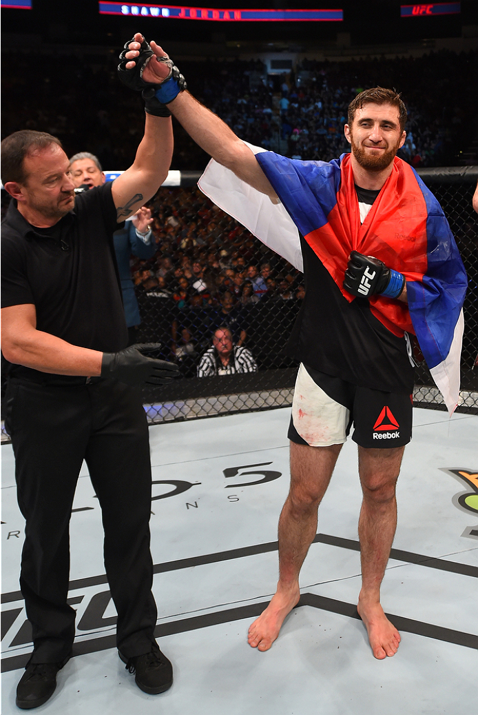 HOUSTON, TX - OCTOBER 03:  Ruslan Magomedov celebrates his victory over Shawn Jordan in their heavyweight bout during the UFC 192 event at the Toyota Center on October 3, 2015 in Houston, Texas. (Photo by Josh Hedges/Zuffa LLC/Zuffa LLC via Getty Images)