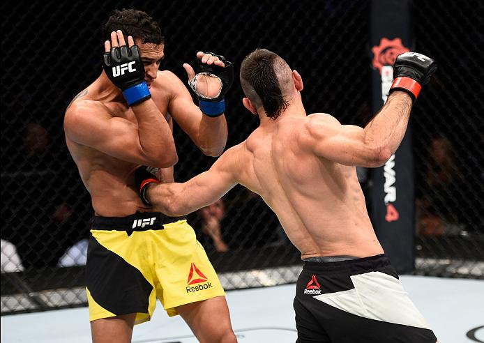 MEXICO CITY, MEXICO - NOVEMBER 05:  (R-L) Ricardo Lamas of the United States punches Charles Oliveira of Brazil in their featherweight bout during the UFC Fight Night event at Arena Ciudad de Mexico on November 5, 2016 in Mexico City, Mexico. (Photo by Jeff Bottari/Zuffa LLC/Zuffa LLC via Getty Images)