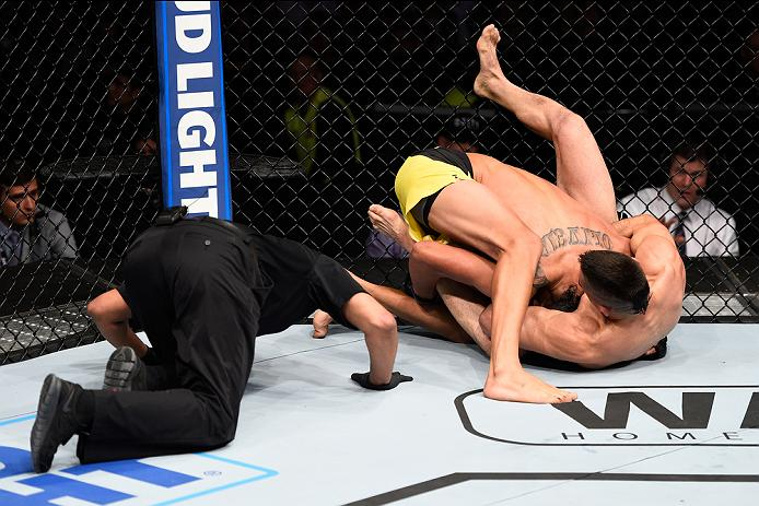 MEXICO CITY, MEXICO - NOVEMBER 05:  (R-L) Ricardo Lamas of the United States submits Charles Oliveira of Brazil in their featherweight bout during the UFC Fight Night event at Arena Ciudad de Mexico on November 5, 2016 in Mexico City, Mexico. (Photo by Jeff Bottari/Zuffa LLC/Zuffa LLC via Getty Images)