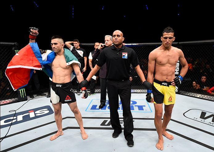 MEXICO CITY, MEXICO - NOVEMBER 05:  (L-R) Ricardo Lamas of the United States celebrates his submission victory over Charles Oliveira of Brazil in their featherweight bout during the UFC Fight Night event at Arena Ciudad de Mexico on November 5, 2016 in Mexico City, Mexico. (Photo by Jeff Bottari/Zuffa LLC/Zuffa LLC via Getty Images)