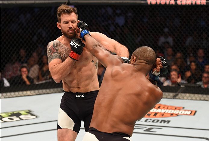 HOUSTON, TX - OCTOBER 03:  (R-L) Rashad Evans punches Ryan Bader in their light heavyweight bout during the UFC 192 event at the Toyota Center on October 3, 2015 in Houston, Texas. (Photo by Josh Hedges/Zuffa LLC/Zuffa LLC via Getty Images)