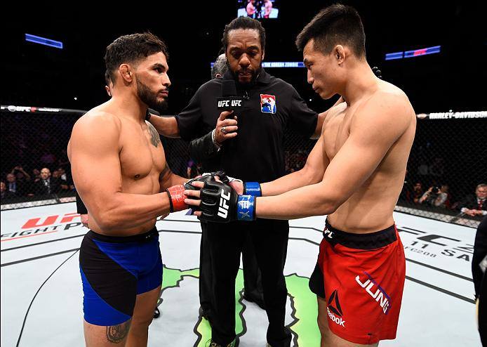 HOUSTON, TX - FEBRUARY 04:  (R-L) Chan Sung Jung of South Korea and Dennis Bermudez touch gloves in their featherweight bout during the UFC Fight Night event at the Toyota Center on February 4, 2017 in Houston, Texas. (Photo by Jeff Bottari/Zuffa LLC/Zuffa LLC via Getty Images)