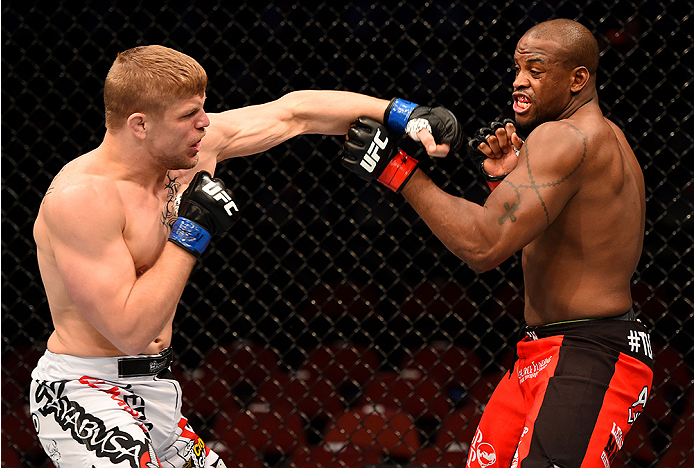 NEWARK, NJ - APRIL 18:  Chris Dempsey punches Eddie Gordon (R) in their middleweight bout during the UFC Fight Night event at Prudential Center on April 18, 2015 in Newark, New Jersey.  (Photo by Josh Hedges/Zuffa LLC/Zuffa LLC via Getty Images)