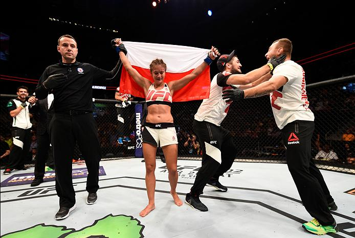 ATLANTA, GA - JULY 30: Karolina Kowalkiewicz celebrates her victory over Rose Namajunas in their women's strawweight bout during the UFC 201 event on July 30, 2016 at Philips Arena in Atlanta, Georgia. (Photo by Jeff Bottari/Zuffa LLC/Zuffa LLC via Getty Images)
