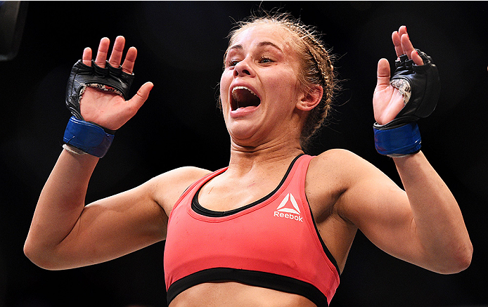 NEWARK, NJ - APRIL 18:  Paige VanZant celebrates defeating Felice Herrig in their women's strawweight bout during the UFC Fight Night event at Prudential Center on April 18, 2015 in Newark, New Jersey.  (Photo by Jeff Bottari/Zuffa LLC/Zuffa LLC via Getty Images)