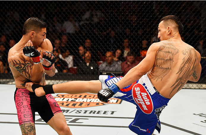 NEWARK, NJ - APRIL 18:  Max Holloway kicks Cub Swanson in their featherweight bout during the UFC Fight Night event at Prudential Center on April 18, 2015 in Newark, New Jersey.  (Photo by Josh Hedges/Zuffa LLC/Zuffa LLC via Getty Images)