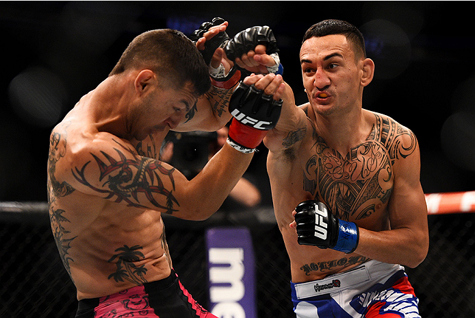 NEWARK, NJ - APRIL 18:  Max Holloway (R) punches Cub Swanson in their featherweight bout during the UFC Fight Night event at Prudential Center on April 18, 2015 in Newark, New Jersey.  (Photo by Jeff Bottari/Zuffa LLC/Zuffa LLC via Getty Images)